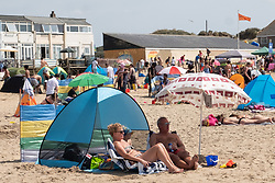 © Licensed to London News Pictures. 04/08/2018. Camber Sands, UK. Large numbers of people are seen on Camber Sands beach in East Sussex during hot weather. Photo credit: Ray Tang/LNP