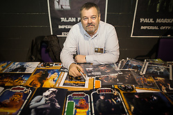 "© Licensed to London News Pictures . 06/12/2015 . Manchester , UK . Signing autographs , ALAN FLYNG who , as well as acting as an Imperial Officer , has appeared in countless films , is a costume supervisor and says he was lead chorister at Winston Churchill's funeral at St Paul's Cathedral . Fans attend Star Wars exhibition "" For the Love of the Force "" at Bowlers Exhibition Centre in Manchester . Photo credit : Joel Goodman/LNP"