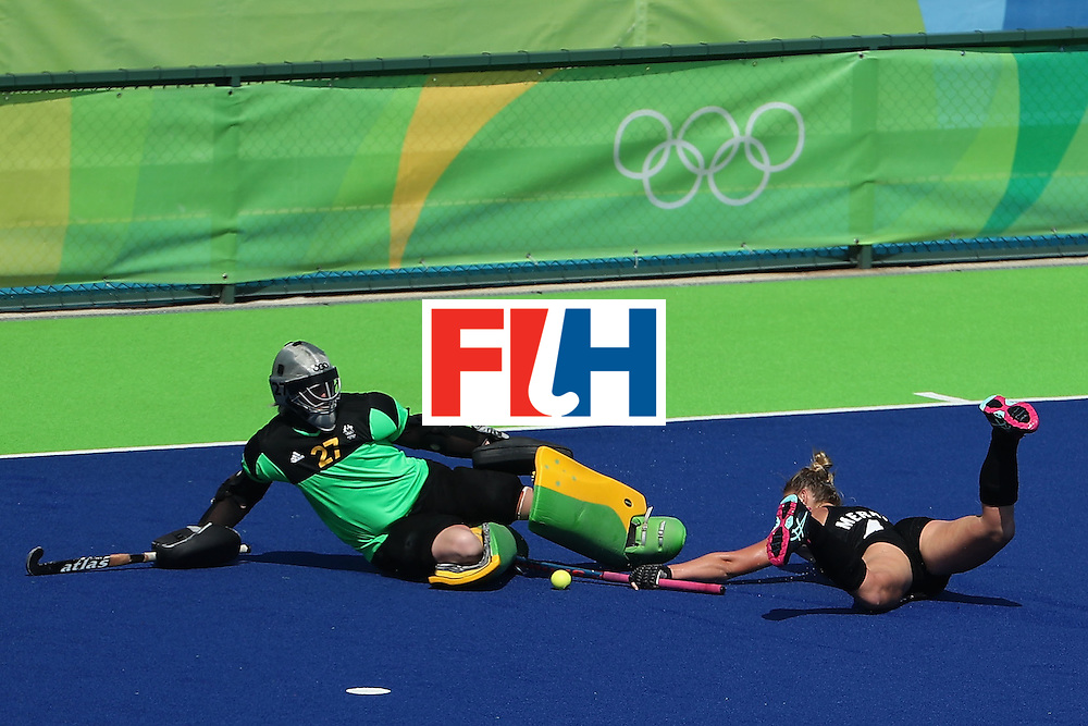 RIO DE JANEIRO, BRAZIL - AUGUST 15:  Goalkeeper Rachael Lynch #27 of Australia makes a save as Olivia Merry #4 of New Zealand slides in during the second half of the quarter final hockey game on Day 10 of the Rio 2016 Olympic Games at the Olympic Hockey Centre on August 15, 2016 in Rio de Janeiro, Brazil.  (Photo by Christian Petersen/Getty Images)