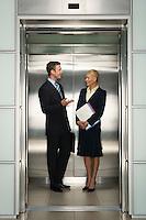 Businesspeople Talking in Elevator