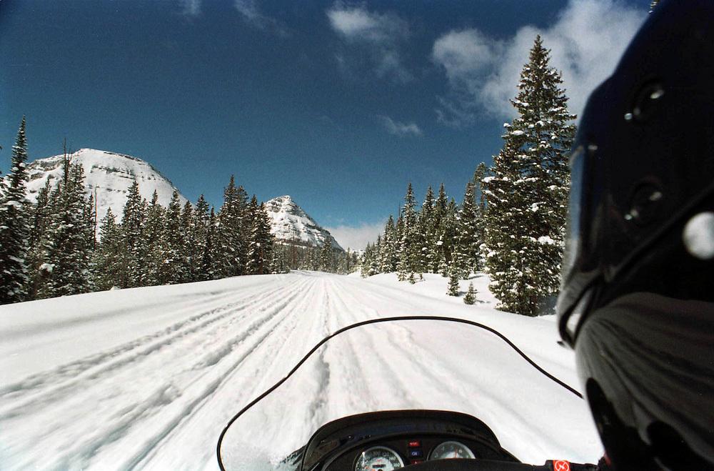 Snowmobiling along the Mirror Lake Highway in Eastern, Utah's Uintah Mountains.  Photo by August Miller