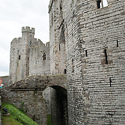 Outside view of one of the gate entrances at Caernarfon Castle in northwest Wales. A castle originally stood on the site dating back to the late 11th century, but in the late 13th century King Edward I commissioned a new structure that stands to this day. It has distinctive towers and is one of the best preserved of the series of castles Edward I commissioned.
