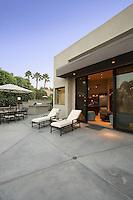 Deckchairs outside modern residence