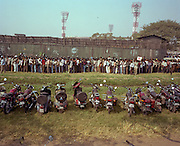 Cricket sports fans queue patiently outside a game venue in Kolkata (Calcutta).