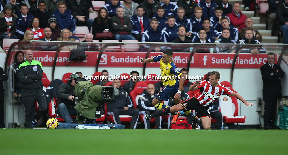 25 October 2014 Premier League Football Sunderland v Arsenal ; a low level television camera follows the action as Lee Cattermole of Sunderland tackles Alex Oxlade-Chamberlain of Arsenal.<br /> Photo: Mark Leech