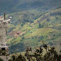 March, 21, 2014 - A statue of Jesus stands looking over the Andes mountains and the town of Jardin in the Department Antioquia region of Colombia.<br /> Story Summary:<br /> Deep in the verdant valleys of Colombia&rsquo;s Department Antioquia region is Fabio Alonso Reyes Cano&rsquo;s coffee finca. Finca La Siemeona has been in Cano&rsquo;s family for generations. <br /> He and two workers farm the 5-acres of land as his ancestors did, bean by bean.  It is a tradition that has dwindled amid modern day farming techniques that harvest quicker but the selectively picked ripe deep red cherries are picked individually by hand for the best quality. &lsquo;Grain by grain&rsquo; processing allows for greater control over that quality of one of Colombia&rsquo;s top exports.  It also may help save an industry that is seeing firsthand the effects of climate change.<br /> Cano takes pride in the organic process, which he practices out of respect for nature and the land he was born and raised on.  A businessman, Cano keeps his eyes on way to grow but he also takes seriously his role as steward, encouraging biodiversity and employing natural pest control on the finca.  His practices are at odds with other coffee farmers, who have adopted more industrialized techniques. <br /> Climate change threatens a way of life that supports about 92,000 families nationwide and serves as one of Colombia&rsquo;s economic backbones.  Colombian coffee production has declined in recent years due to regional climate change associated with global warming as both the average temperatures have risen and an increase in rainfall.  The trend disrupts the specific climate requirements to grow the Coffea Arabica bean, and a way of life.  (Credit Image: &copy; Eric Reed/ZUMAPRESS.com)