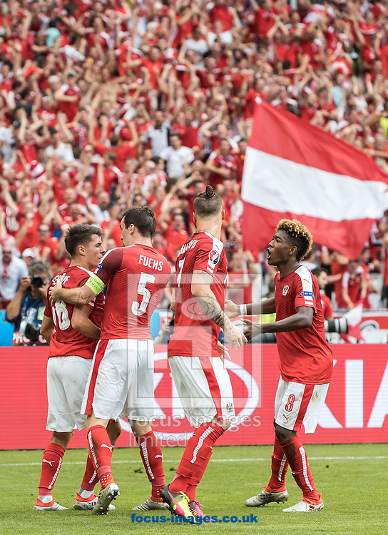Alessandro Schoepf (left) of Austria celebrates his goal during the UEFA Euro 2016 match at Stade Velodrome, Marseille, France.<br /> Picture by EXPA Pictures/Focus Images Ltd 07814482222<br /> 22/06/2016<br /> *** UK &amp; IRELAND ONLY ***<br /> EXPA-FEI-160622-5047.jpg