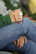A rosary dangles from the hand of a St. John Bosco Youth Day participant. (Photo by Sam Lucero)