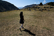 Selim Pass, one part of the original route of the great Silk road in the days when it ran from Iran through Goris in Armenia on its way to Europe.  A small girl in the village of Yeghegis, which has a rare concentration of churches..Image © Arsineh Houspian/Falcon Photo Agency.