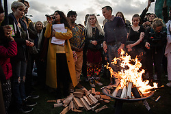 © Licensed to London News Pictures. 06/10/2019. London, UK. Extinction Rebellion (XR) activists gather in Marble Arch ahead of a week of planned actions across the capital. A ceremony was performed lighting a beacon and torches. Photo credit: Guilhem Baker/LNP