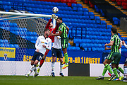 Bolton Wanderers goalkeeper Ben Alnwick (13) punches clear from AFC Wimbeldon midfielder Tom Soares (14)  during the EFL Sky Bet League 1 match between Bolton Wanderers and AFC Wimbledon at the Macron Stadium, Bolton, England on 4 March 2017. Photo by Simon Davies.