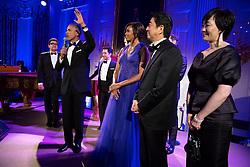 """President Barack Obama, First Lady Michelle Obama, Prime Minister Shinzo Abe of Japan and First Lady Akie Abe join the cast of """"Jersey Boys"""" on stage after their State Dinner performance in the State Dining Room of the White House, April 28, 2015. (Official White House Photo by Pete Souza)<br /> <br /> This official White House photograph is being made available only for publication by news organizations and/or for personal use printing by the subject(s) of the photograph. The photograph may not be manipulated in any way and may not be used in commercial or political materials, advertisements, emails, products, promotions that in any way suggests approval or endorsement of the President, the First Family, or the White House."""