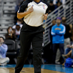 February 7, 2011; New Orleans, LA, USA; Referee Violet Palmer (12) runs the court during the first quarter of a game between the New Orleans Hornets and the Minnesota Timberwolves at the New Orleans Arena.   Mandatory Credit: Derick E. Hingle