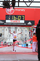 Harriet Knowles-Jones crosses the line to win the regional division of the Girls U17 race in the Virgin Giving Mini London Marathon, Sunday 26th April 2015.<br /> <br /> Scott Heavey for Virgin Money London Marathon<br /> <br /> For more information please contact Penny Dain at pennyd@london-marathon.co.uk