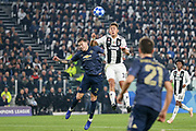 Manchester United Defender Victor Lindelof jumps for a header with Juventus Forward Paulo Dybala during the Champions League Group H match between Juventus FC and Manchester United at the Allianz Stadium, Turin, Italy on 7 November 2018.