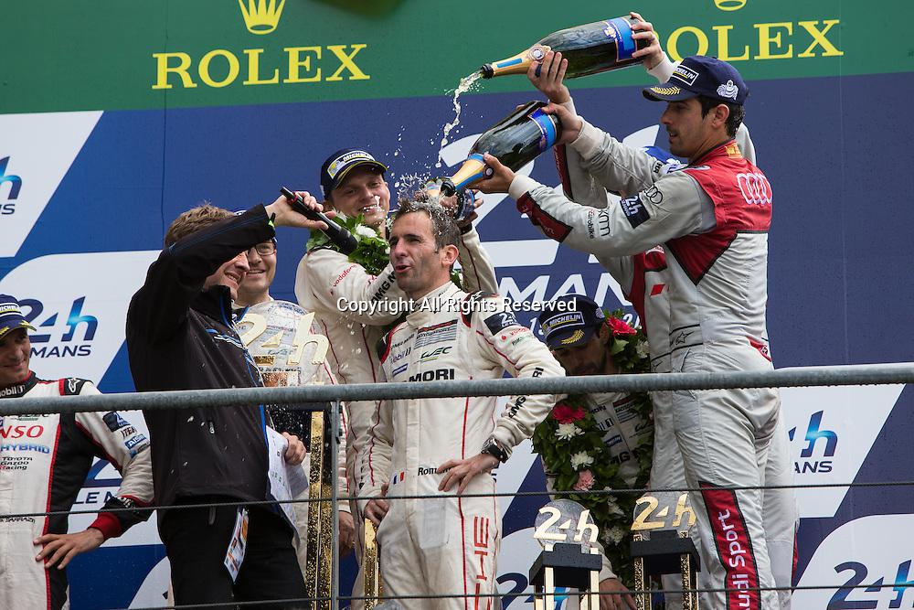 19.06.2016. Le Mans Circuit, Le Mans, France. Le Mans 24 Hours Race. Porsche Team driver Romain Dumas gets soaked with champagne.