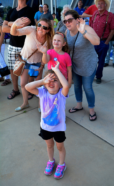 gbs062517b/ASEC - Colleen Franco of Albuquerque, with cousins, Francesca, 4, Giulianna, 6, and Kelly Depari, of Humble Texas, from left, wave at  a Drone taking video of the crowd at the Drone Discovery Day at the Anderson Abruzzo Albuquerque International Balloon Museum on Sunday, June 25, 2017. (Greg Sorber/Albuquerque Journal)