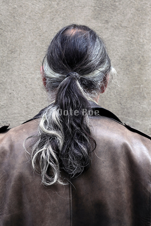 rear view portrait of man with ponytail