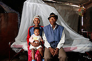 Bonafactious 20 Oroses with wife Valencia 17 and daughter Patricia who is 1 and therefore has a high risk of catching malaria. Bonfactious had malaria while he was still in school some years back. He was admitted to hospital with a severe headache and unable to eat. He was in hospital for two months so got behind on his education. He noted that many, many children at his school also suffered from malaria and missed their schooling. This is the first time they are receiving a bed net. Tsumeb, Northern Namibia. November 16th 2010. .Picture by Zute Lightfoot www.lightfootphoto.com