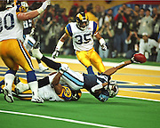Tennessee Titans WR Kevin Dyson is tackled just short of the goal line by St. Louis Rams LB Mike Jones on the last play of Super Bowl XXXIV at the Georgia Dome in Atlanta, GA on January 30, 2000, to give Dick Vermeil his 1st Super Bowl victory.  The Rams beat the Titans 23-16.
