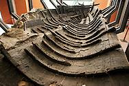 Ercolano, Italia - 23 novembre 2012. Un raro esempio di barca di età romana ritrovata all'interno degli scavi archeologici di Ercolano (Herculaneum). In tantissimi tentarono la fuga dall'eruzione del Vesuvio via mare. Il sito archologico di epoca romana, patrimonio dell'Unesco, distante solo pochi km da Pompei, ha riportato alla luce tesori antichi di inestimabile valore. A differenza di Pompei, ad Ercolano sono stati ritrovati reperti organici ed in legno che hanno permesso agli archeologi di studiare in modo più approfondito le abitudini dell'epoca. Ph. Roberto Salomone Ag. Controluce.ITALY - SA rare example of a perfectly preserved boat of roman age that was found inside of the archeological site of Herculaneum on November 23, 2012. The world heritage site of roman age, just a few miles away from Pompeii has brought to life treasures that made it possible for archeologists to study in a more detailed way the lifestyle of ancient romans.