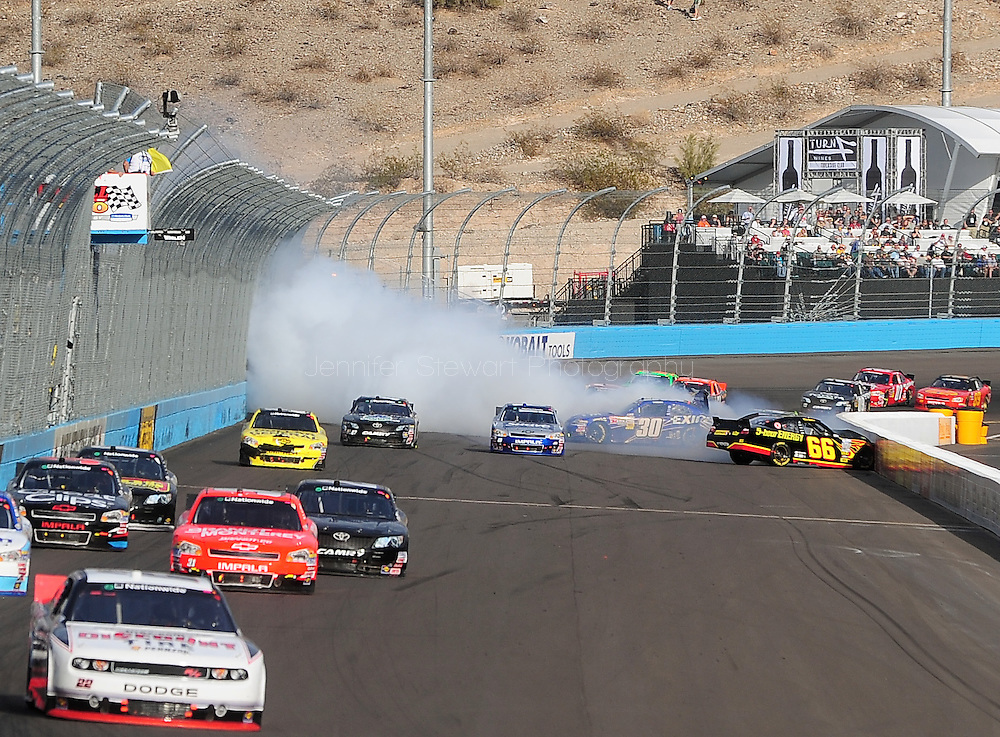 Nov. 12 2011; Avondale, AZ, USA; NASCAR Nationwide Series driver Steve Wallace (66) crashes into the wall during the Wypall 200 at Phoenix International Raceway. Mandatory Credit: Jennifer Stewart-US PRESSWIRE