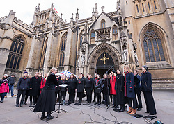 "© Licensed to London News Pictures. 27/10/2018. Bristol, UK. Picture of Military Wives Choir at The Royal British Legion launch this year's Bristol Poppy Appeal, ""One thousand poppies, for one hundred years, for one million lives"" at Bristol Cathedral. For the launch of the 2018 Bristol Poppy Appeal at 11am on 27 October, the Royal British Legion recreated a scene from the end of WW1 outside Bristol Cathedral on College Green, and Colonel Clive Fletcher-Wood read the war poem In Flanders Fields. They were joined by Civic Dignitaries Peaches Golding the Lord Lieutenant of Bristol, City of Bristol High Sheriff Mr Roger Opie, and Bristol's Lord Mayor Cleo Lake. A Bugler and the Bristol Military Wives Choir performed songs from their new album 'Remember'. Staff at MOD Filton filled 400 sandbags with eight tonnes of sand to build trenches and recreate 'Flanders Fields' and planted over 1000 waterproof poppies on College Green. Poppies and sandbags can be sponsored by individuals wanting to remember those who fought and died in conflict. There were re-enactors in WW1 uniform from Somerset Light Infantry (known as the West Country Tommys), as well as medics and nurses with equipment from the time. Bristol's own 'War Horse' (Buzz from Blagdon Horsedrawn Carriages) was on College Green behind the improvised barbed wire to represent the 350,000 horses that left Avonmouth for the frontline during WW1. There are also 10,000 knitted poppies on display both in and outside Bristol Cathedral following 'The Charfield Yarn Bombers' incitement to locals to get knitting to mark the occasion, with a display inside the Cathedral organised by Helen Date. Photo credit: Simon Chapman/LNP"