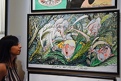 "© Licensed to London News Pictures. 31/03/2017. London, UK. A staff member views ""Lost in the Brexit Jungle"", 2017, by Gerald Scarfe (Est GBP 5-7k).  The work depicts Theresa May, Boris Johnson, Nigel Farage and Alex Salmond).  Press preview of ""Made in Britain"" at Sotheby's in New Bond Street.  The auction on 5 April celebrates innovative British art in the twentieth century as well as artwork by political cartoonist Gerald Scarfe. Photo credit : Stephen Chung/LNP"