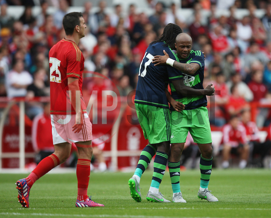 Andre Ayew of Swansea City (R) celebrates with Eder (C) after scoring his sides first goal<br /> <br />  - Mandatory by-line: Jack Phillips/JMP - 25/07/2015 - SPORT - FOOTBALL - Nottingham - The City Ground - Nottingham Forest v Swansea - Pre-Season Friendly