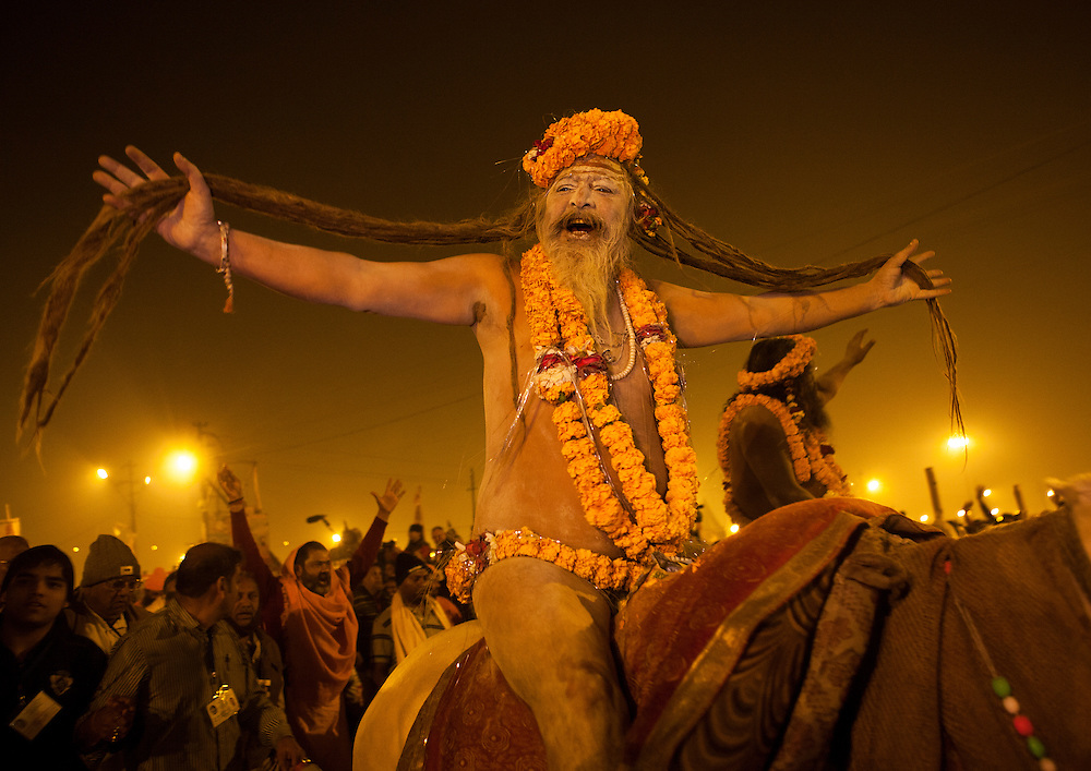 Naga Sadhu from Juna Akhara going to bath, Maha Kumbh Mela festival, world's largest congregation of religious pilgrims. Allahabad, India.