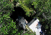 Sinkhole cliff diving competition held in Mexico<br /> <br /> Daredevil athletes have jumped from the edge of a 90ft deep sinkhole in a remote part of Mexico, as part of a cliff diving contest.<br /> Divers in the 'Cliff Diving World Series' performed stunts and reached speeds of 40mph before hitting the dark water of Cenote Ik Kil.<br /> Gary Hunt, from Southampton was the overall winner and managed to pull off a Triple Quad – one of the most difficult dives in the world.<br /> The Red Bull event lasted for two days -- though most of that time was probably taken up trying to get back out after each jump. <br /> Gary scored 373.85 and edged out second-placed Silchenko by a little over 10 points, with 2009 champion Duque taking third place.<br /> <br /> Photo Shows: Steve Black of Australia dives from the 27.2 metre platform during round two of the 2010 Red Bull Cliff Diving World Series, Cenote Ik Kil, Yucatan, Mexico on June 05; 2010.<br /> (©Ray Demski/Exclusivepix)