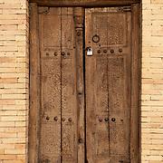 A wooden door to the Il-Arslan Mausoleum in the ruins of Konye-Urgench, Turkmenistan