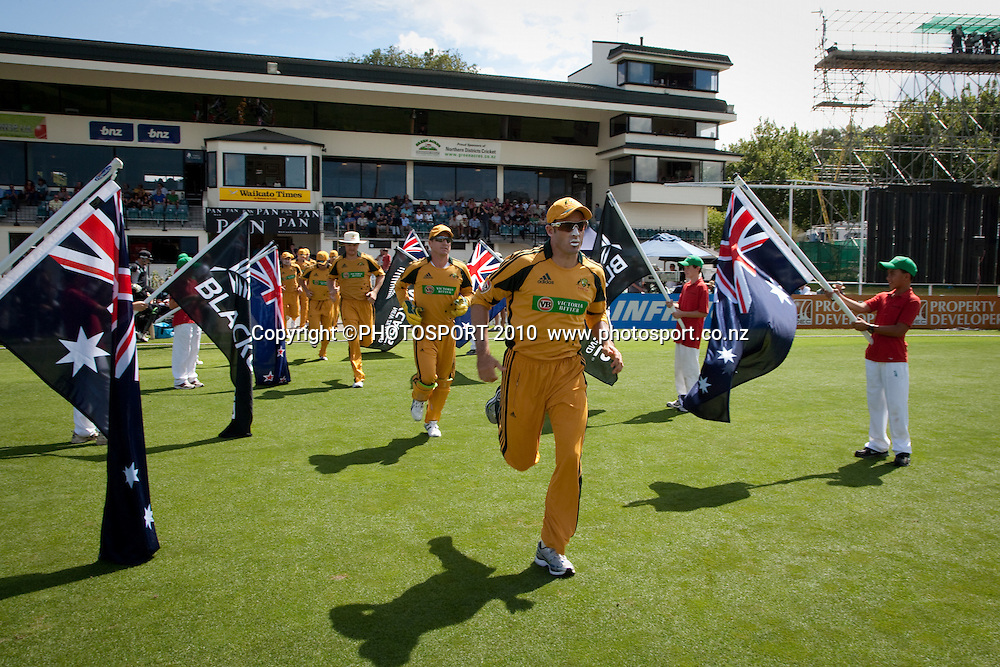 Australian team run onto the field for the start of play at the third one day Chappell Hadlee cricket series match between New Zealand Black Caps and Australia at Seddon Park, won by Australia by 6 wickets in Hamilton, New Zealand. Tuesday 9 March 2010. Photo: Stephen Barker/PHOTOSPORT