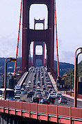 Traffic on the Golden Gate Bridge, San Francisco, California. The Golden Gate Bridge is a suspension bridge spanning the Golden Gate, the opening of the San Francisco Bay onto the Pacific Ocean. As part of both US Highway 101 and State Route 1, it connects the city of San Francisco on the northern tip of the San Francisco Peninsula to Marin County. The Golden Gate Bridge had the longest suspension bridge span in the world when it was completed in 1937 and has become an internationally recognized symbol of San Francisco and the United States..Subject photograph(s) are copyright Edward McCain. All rights are reserved except those specifically granted by Edward McCain in writing prior to publication...McCain Photography.211 S 4th Avenue.Tucson, AZ 85701-2103.(520) 623-1998.mobile: (520) 990-0999.fax: (520) 623-1190.http://www.mccainphoto.com.edward@mccainphoto.com.