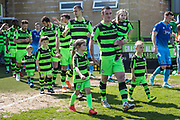 Forest Green Rovers Lee Collins(5) leads the teams out during the EFL Sky Bet League 2 match between Forest Green Rovers and Grimsby Town FC at the New Lawn, Forest Green, United Kingdom on 5 May 2018. Picture by Shane Healey.