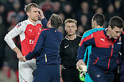 Per Mertesacker (Arsenal) gets to his feet after a clash of heads with Nick Powell (Hull City). Long delay during the The FA Cup fifth round match between Hull City and Arsenal at the KC Stadium, Kingston upon Hull, England on 8 March 2016. Photo by Mark P Doherty.