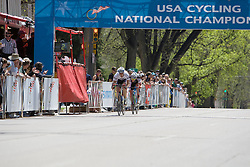 Craig Leukens (Yale University) catches Spencer Beamer (Furman University) with 2 laps to go.  The 2008 USA Cycling Collegiate National Championships Criterium men's division 2 event held in Fort Collins, CO on May 11, 2008.