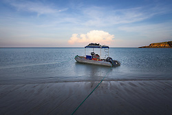 Naturalist Richard Costin's dinghy loaded with swag and stores on the beach at Macleay Island.