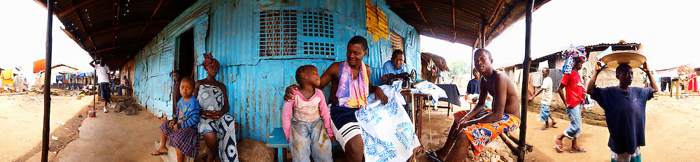 Mohamed and Kadiatu with their children at home. Mohamed and Kadiatu lost a child to malaria some years ago, Kroo Bay, Freetown, Sierra Leone.