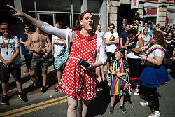"© Licensed to London News Pictures . 24/08/2019. Manchester, UK. A member of the crowd remonstrates with a protest by Lesbians opposed to some concepts of Transgender Identity , referred to as "" TERFS "" blocks the parade . The 2019 Manchester Gay Pride parade through the city centre , with a Space and Science Fiction theme . Manchester's Gay Pride festival , which is the largest of its type in Europe , celebrates LGBTQ+ life . Photo credit: Joel Goodman/LNP"