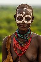 Kara tribe woman in their village high above the Omo River,  Omo Valley, Ethiopia.