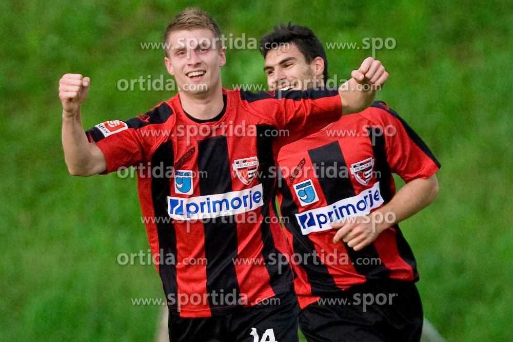 Saso Ogric of Primorje celebrates after he scored a goal in last minute at football match between NK Primorje Ajdovscina and NK Triglav Gorenjska of Second Slovenian football league, on May 16, 2010 in Vipava, Slovenia. Primorje placed first in 2.SNL and qualified for  PrvaLiga in season 2010/2011. (Photo by Urban Urbanc / Sportida)