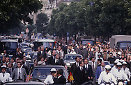 President Jimmy Carter in a motorcade parade in Berlin on July 16, 1978.  The press cpool was put in open trucks (basically farm truck with bunting voering up the railing side boards)<br />Photo by Dennis Brack
