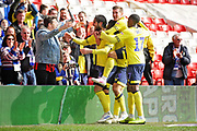 Blackburn Rovers forward Danny Graham (10) celebrates with team mates and a Blackburn Rovers fan after scoring the winning goal for Blackburn  during the EFL Sky Bet Championship match between Nottingham Forest and Blackburn Rovers at the City Ground, Nottingham, England on 13 April 2019.