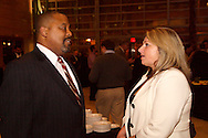James Cosby (left) and Amy Ross, both of the Cox Media Group during the Dayton Development Coalition annual meeting in the Schuster Center in downtown Dayton, Wednesday, January 11, 2012.