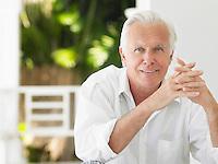Man sitting on verandah portrait