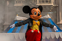 Mickey Mouse performs in front of the Cinderella Castle, Magic Kingdom, Walt Disney World, Orlando, Florida USA