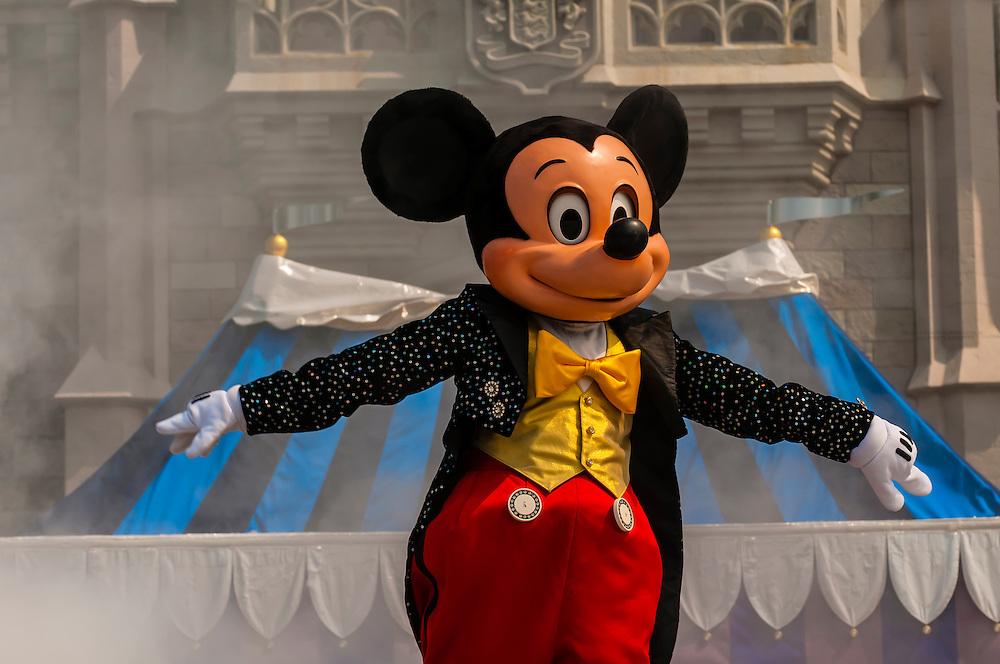 Mickey Mouse performs in front of the Cinderella Castle, Magic Kingdom, Walt Disney World, Orlando, Florida USA