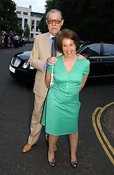 VALERIE KLEEMAN and ALAN WHICKER at Sir David & Lady Carina Frost's annual summer party held in Carlyle Square, Chelsea, London on 5th July 2006.<br />