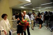 Roma 21 Luglio 2010  .Lauree  notturne alla Facolta di Ingegneria all'Università di Tor Vergara, per protestare contro il disegno di legge Gelmini e la manovra finanziaria del Governo Berlusconi.Una ragazza appena laureata festeggiata dai parenti.Rome 21 July 2010.Graduation night at the Faculty of Engineering at the University of Tor Vergara, to protest against the sketch of law Gelmini and the financial manoeuvre of the Government Berlusconi